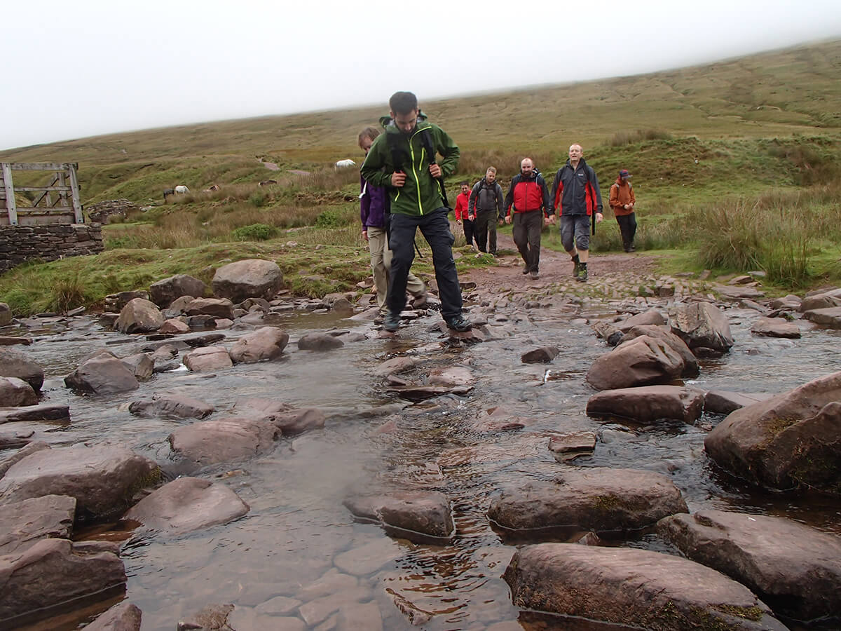 Crossing a river on a mountain walk