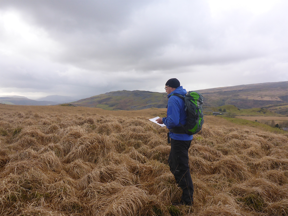 A man navigating his way through the Brecon Beacons