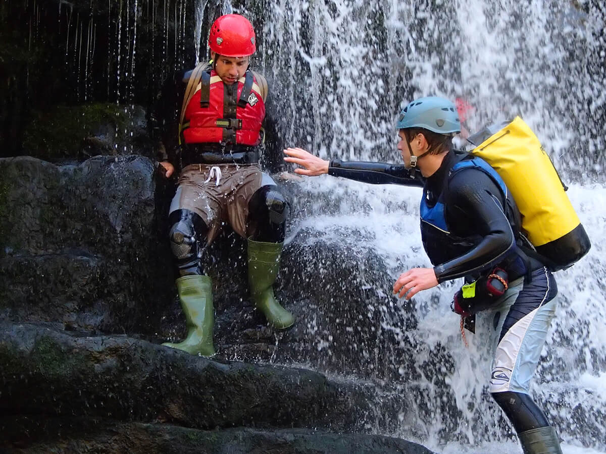 Instructor and client Canyoning
