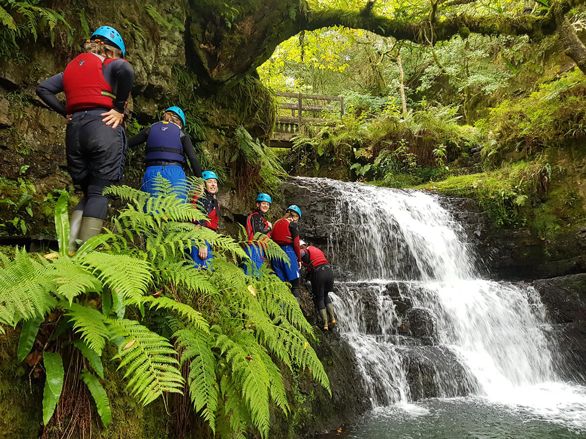 Group getting ready to jump off a waterfall